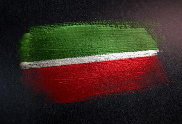 Tatarstan flag made of metallic brush paint on grunge dark wall