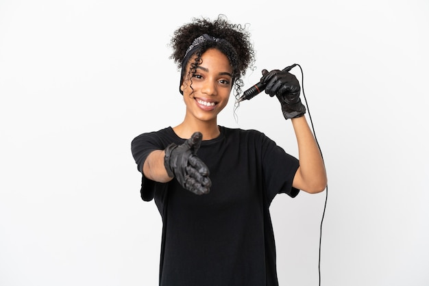 Tattoo artist latin woman isolated on white background shaking hands for closing a good deal