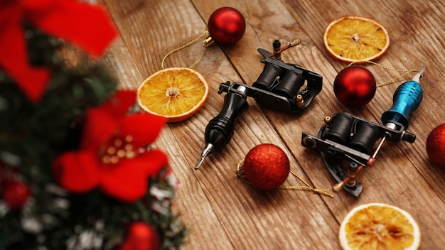 Tattoo machines on a christmas background