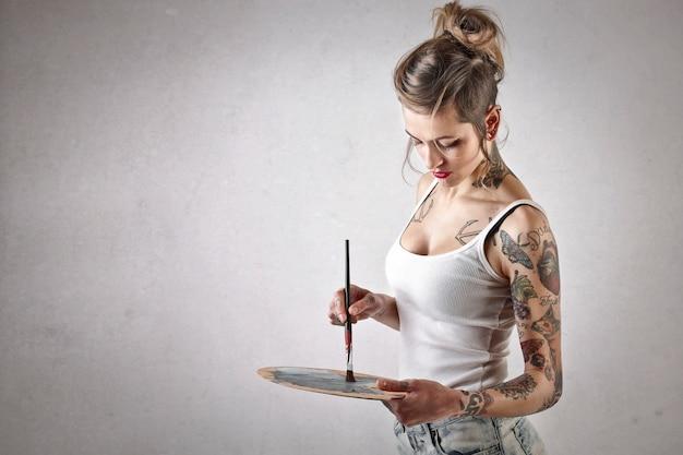 Tattooed artist painter