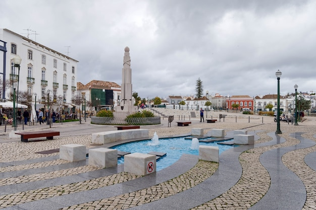 Tavira, southern algarve/portugal - march 8 : water feature in the square at tavira portugal on march 8, 2018. unidentified people