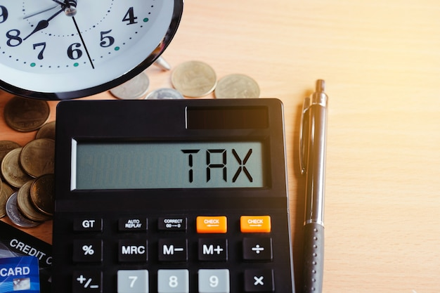Tax 2021 business finance concept. calculator with money and credit card on table.annual tax payment