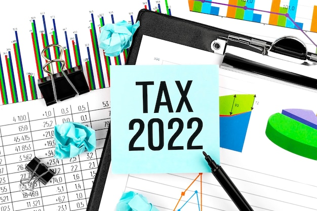 Tax 2022. sticker, chart, clipboard. business and tax concept. flat lay.