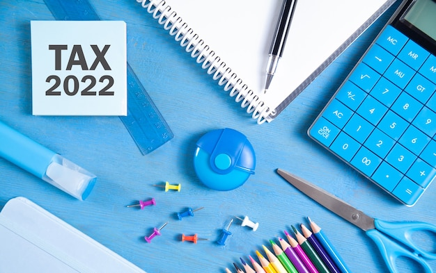 Tax 2022 on sticky note with business objects