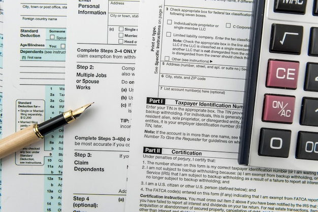 Tax concept 1040 tax form with calculator on desk
