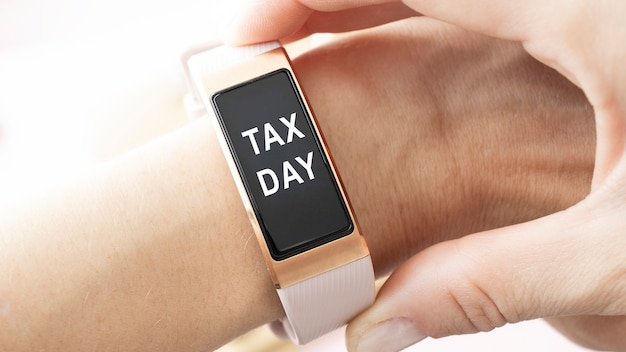 Tax day inscription on clock, tax collection concept.