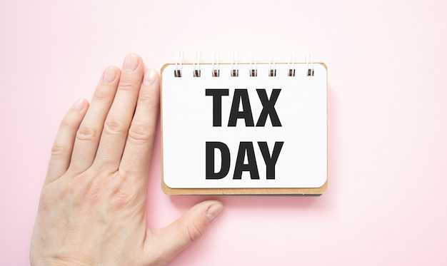 Tax day text with hand