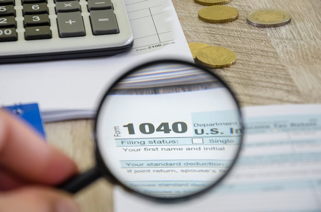 Tax form 1040 and magnifier