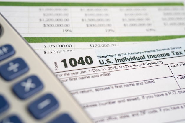 Tax return form 1040 and dollar banknote, u.s. individual income.
