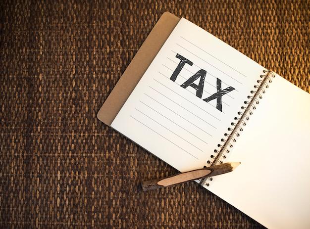 Tax written on a notebook
