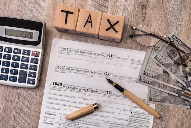 Taxation company on wooden table 1040 form with dollar