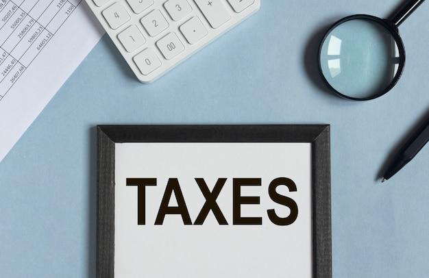 Слово о налогах на бумаге для напоминания