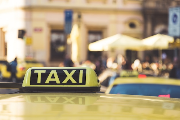 Taxi cars are waiting in row on the street in prague, european tourism and travel concept, selective focus