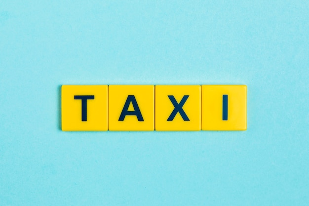 Taxi word on scrabble tiles