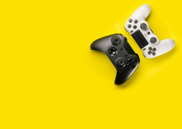 Tblack and white game controllers