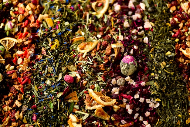 Tea background: green, black, floral, herbal, mint, melissa, ginger, apple, rose, lime tree, fruits, orange, hibiscus, raspberry, cornflower, cranberry.