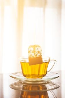 Tea bag inside a cup