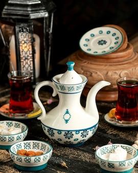 Tea black tea with lemon turkish delight and dried flowers on table
