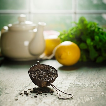 Tea composition on wooden table, close up