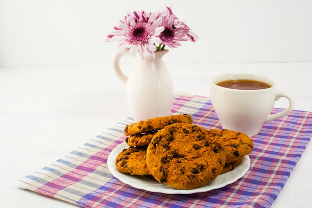Tea and cookies served on checkered napkin