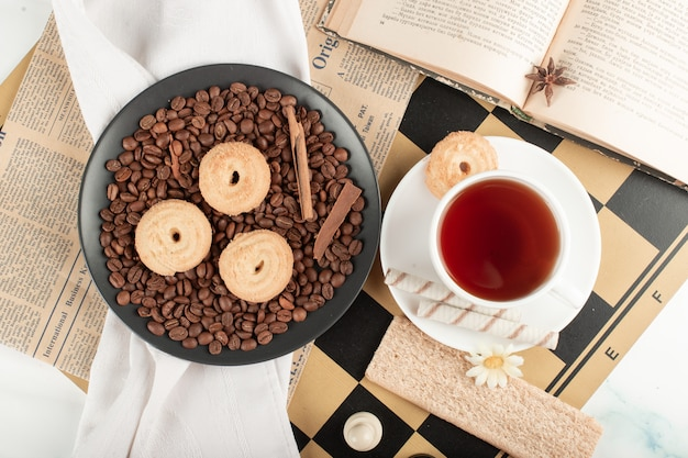 Tea cup and cookie platter on a chessboard