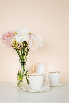 Tea cup next to flower bouquet