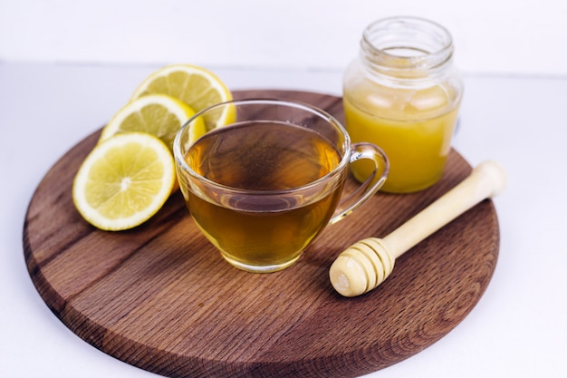 Tea cup, honey jar and lemon