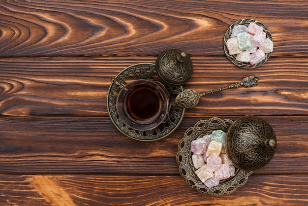 Tea cup with turkish delight on table