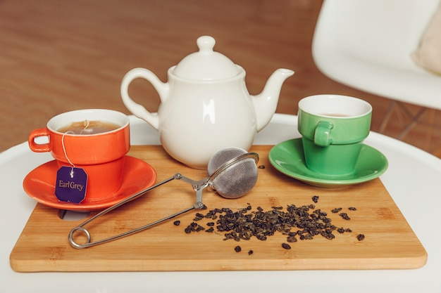 Tea decoration with two cups and teapot