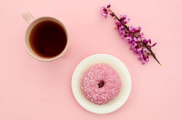 Tea next to a donut