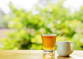 Tea drinks with nature tree bokeh sunlights backgrounds