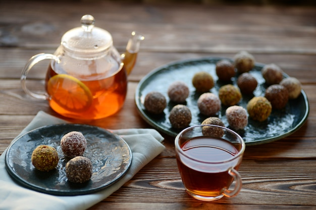 Tea in glass teapot, cup and energy balls