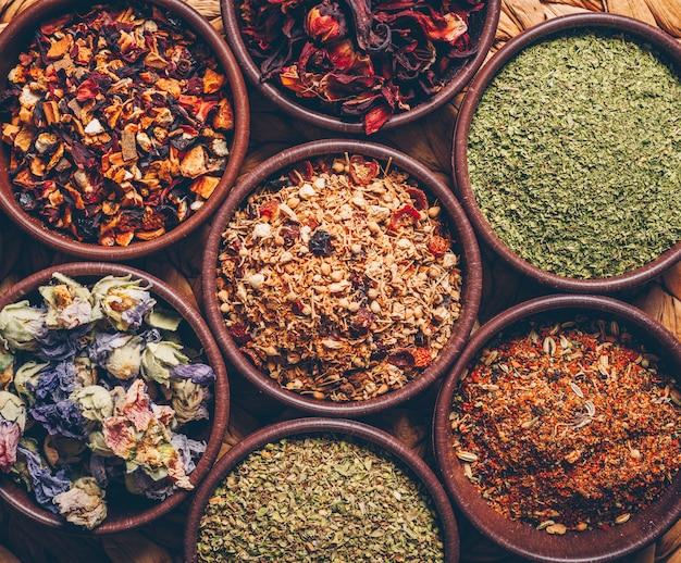 Tea herbs in bowls. flat lay.