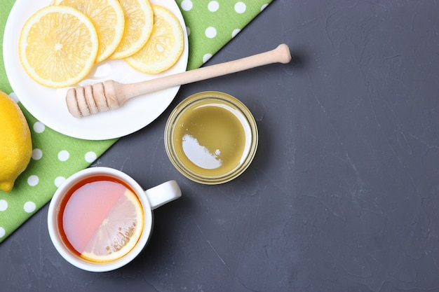 Tea honey and lemon on the table top view