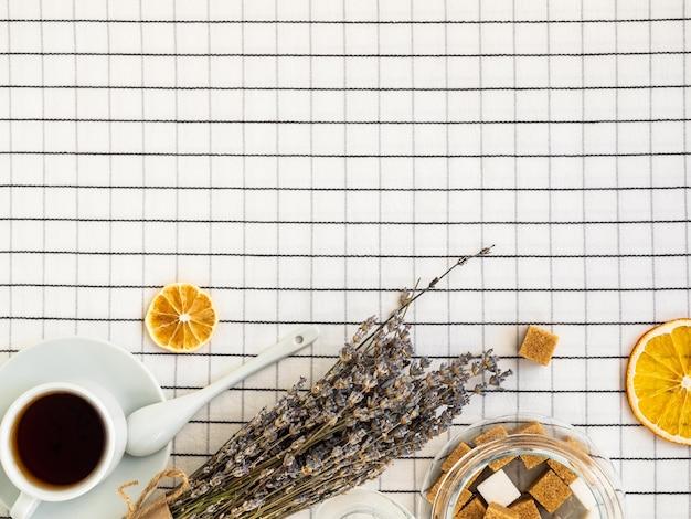 Tea, lavender, sugar on the table, copy space