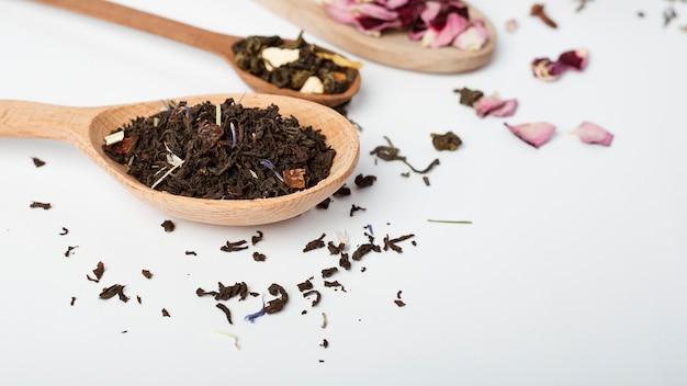 Tea leaves on wooden spoon