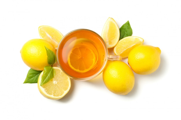 Tea and lemons isolated, top view