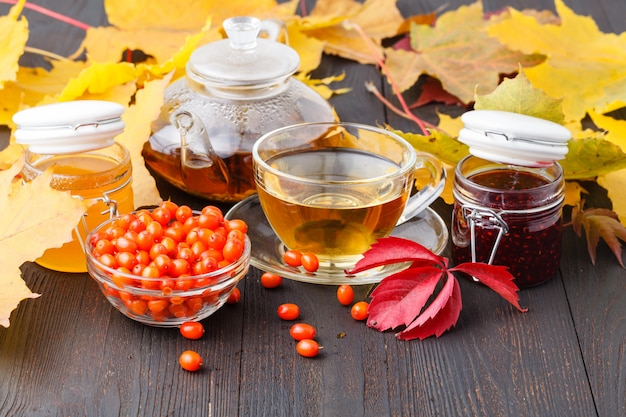 Tea made from sea buckthorn berries healthy for health delicious, saturated with vitamins surrounded by berries and sea buckthorn leaves for maintaining health in the body