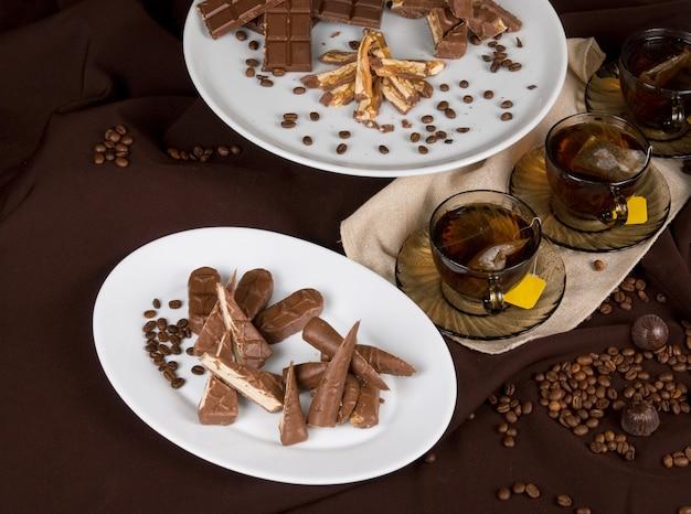 Tea party set on dark brown background