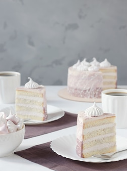 Tea party with a gentle cake and meringues