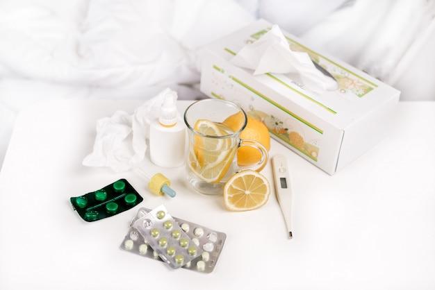 Tea and pills on table
