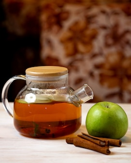 Tea pot with apple slices and cinnamon