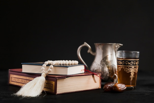 Tea pot with quran book on table