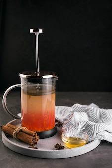Tea press with honey cinnamon