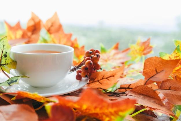 Tea set among autumn leaves
