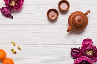 Tea set and flowers on wooden tabletop