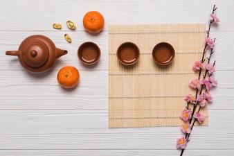 Tea set and sakura branch