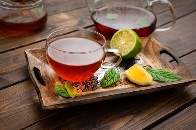 Tea set composition on wooden palette in rustic style