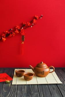 Tea set on lumber tabletop near branch