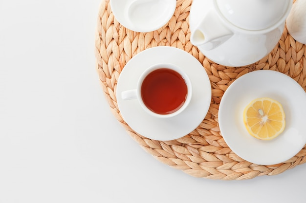 Tea set in a minimalistic scandinavian style. white dishes on an isolated background. view from above.